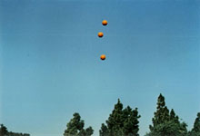 John BALDESSARI: Throwing three balls in the air to get a straight line.